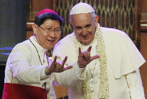 3-fingered gesture of the Pope